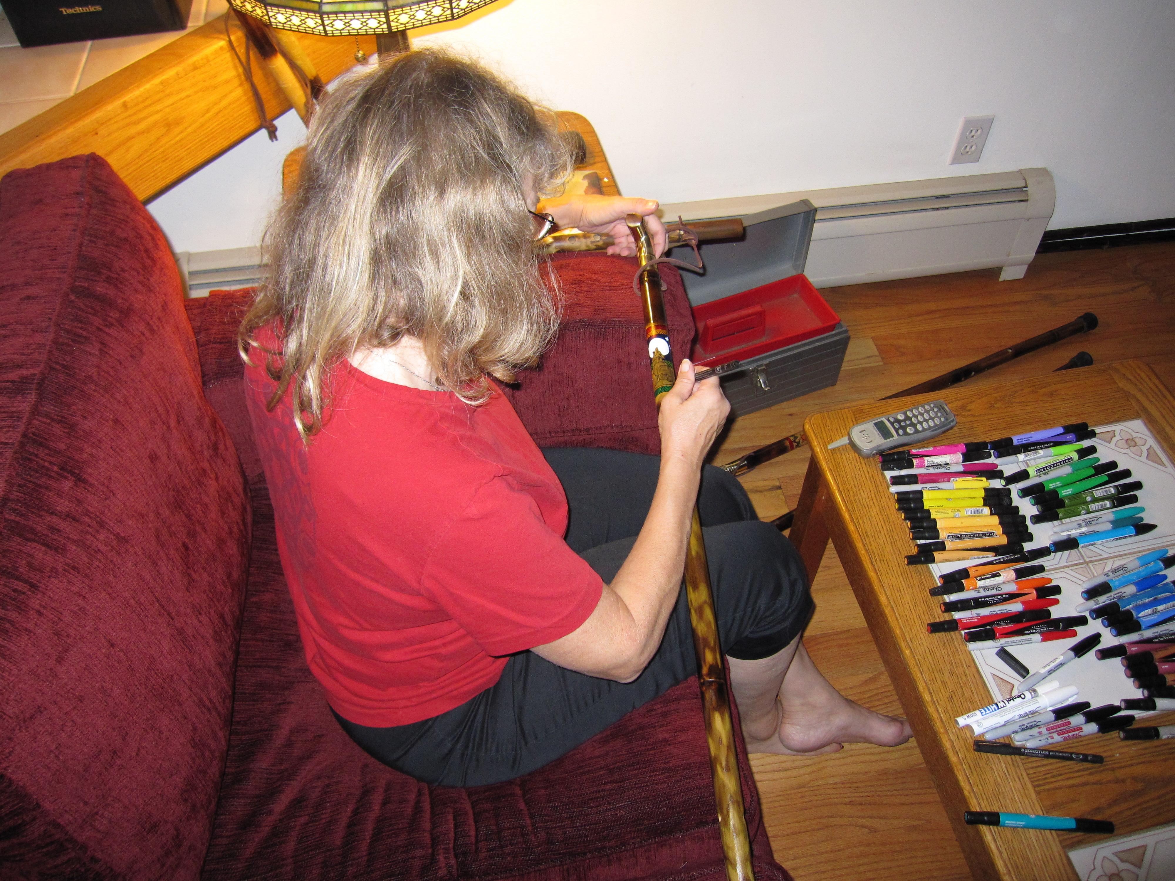 Linda Drawing on Walking Stick